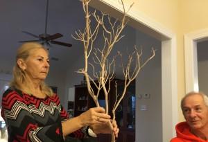 Pamela Allen Boussard help Alison demonstrate items for decorations.