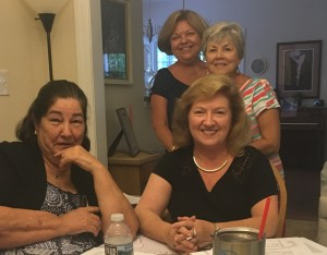 """L-R Rosemary Pelland Watkins, Alison Sineath Smith, Linda Kalnen (seated) Linda Cunnington Page are happy business is concluded and are moving to the special """"treat"""" prepared."""